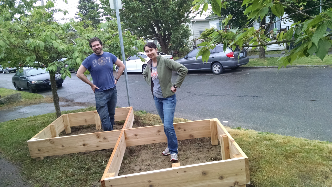 Couple Build A Raised Garden On Their Front Lawn To Grow Food For Themselves & Their Neighbors...
